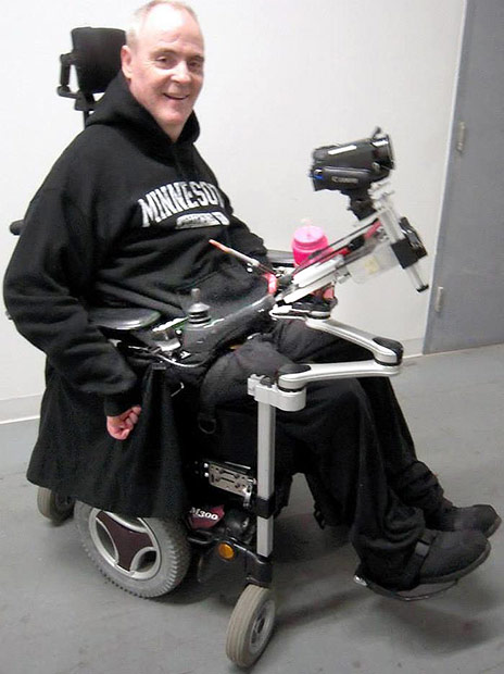 Happy man in wheelchair with mount and accessories.
