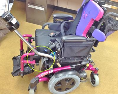 Daessy system with an offset attached to the armrest of an Invacare TDX