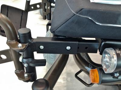 Use existing bolt holes in frame to attach mount; replace with longer bolts if necessary.