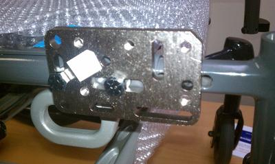 An Adapter Plate 4 is attached using the hardware provided