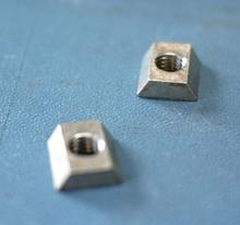 Dovetail nuts for Quickie 646 slide track