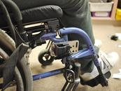The Solid Wheelchair bracket then attaches to the Adapter Plate.