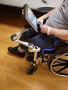 The Solid Wheelchair Bracket is attached to the front of the L-Angle Extension so the brake may be used. This person does not use their footrests.