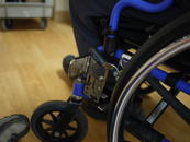 Attach an L-angle extension to offset the Wheelchair bracket forward, away from the brake. Your set-up may differ.