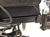 Side view: the attachment bolts are just inside the footrest hangers.