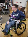 The positioning also allowed for transfers to a walker. His walker has a Tilt'n Turner attached, so he detaches his speech device from the chair and moves it to the walker.