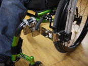 The bracket and post needed to be located to allow wheelchair propulsion and brake use, as well as positioned back to allow pulling up to a table.