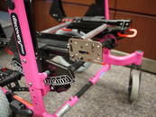 Attach the Adapter Plate 4 to the side frame, orienting the threads for easy attachment of the Wheelchair Bracket.