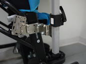 Attach pair of L-Angle Extension plates to offset for tray width. Attach the Wheelchair Bracket