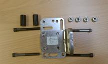 Two Adapter Plates are used to sandwich the rectangular tube. Long bolts and nuts are used to secure the assembly. Spacers are needed to locate the plates.