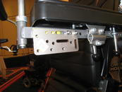 Approach 2: Attach an Adapter Plate 2 to the holes in the armrest bracket.