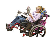 She needs to tilt her wheelchair throughout the day, but she can still access her ipad!