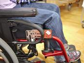 In this case, the Adapter Plate 4 is attached to the frame in a vertical orientation. The Adapter Plate 2 is attached to the AP4, bringing the Wheelchair Bracket placement forward, past the armrest.