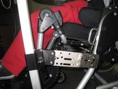 "Attached with a 1"" round clamp, Adapter Plate 4, Adapter Plate 2, and adjustable Wheelchair Bracket. It is recommended to use a Solid Wheelchair Bracket and Angle Adjustment Plate."