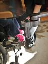 An L-Angle Extension is shown attached to offset/reposition the Wheelchair Bracket.