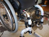 A tight squeeze: an AP4 plate attaches to the Oval bridge clamps. Wheelchair Bracket is placed forward to allow brake use.