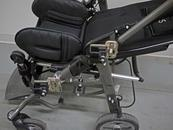 Two Wheelchair Brackets are attached-one with collar clamps and one with bridge clamps