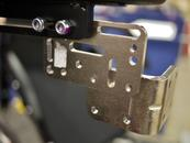 This example shows the L-Angle Extension Plate attached lower, to offset the Solid Wheelchair Bracket so the mount can be positioned lower.
