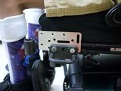 "Adapter Plate ""sandwiched"" between tie-down and wheelchair; attach the Wheelchair Bracket to the Adapter Plate."
