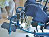 Attach an Angle Adjust Plate (WC-AAP) and Solid Wheelchair Bracket to get the post vertical